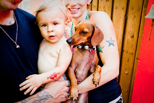tattoed mom and dad with baby : Stock Photo