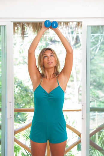 woman exercising with hand weights : Stock Photo