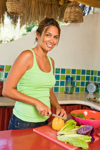 woman preparing food in kitchen : Stock Photo