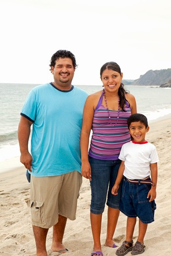 young mexican family on beach : Stock Photo