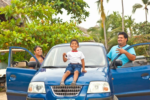 young mexican family with car : Stock Photo