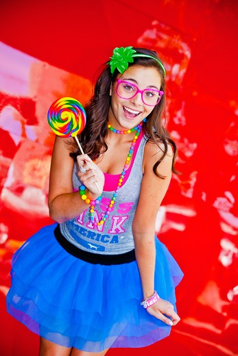 Stock Photo: 1530R-41333 teen girl with large lollipop