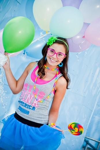 Stock Photo: 1530R-41337 teen girl holding bunch of balloons