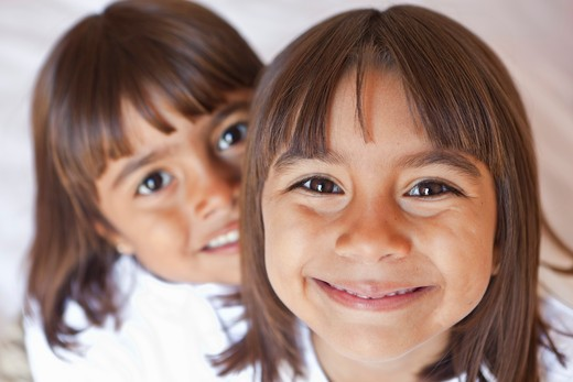 portrait of two smiling young girls : Stock Photo
