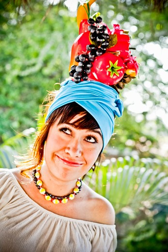 young woman wearing fruit hat : Stock Photo