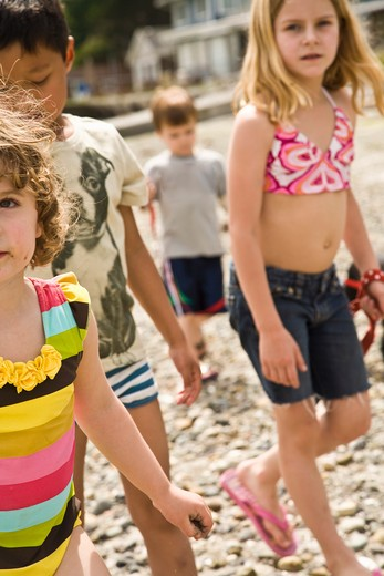 group of children walking on beach : Stock Photo