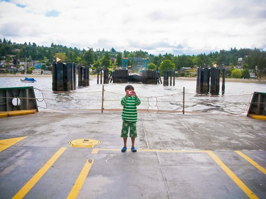 Stock Photo: 1530R-41662 Boy standing on car deck of ferry,  Puget Sound, Washington USA