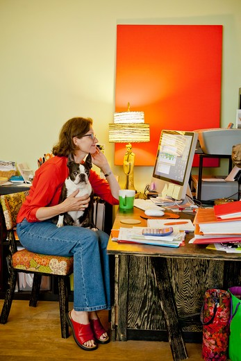 Stock Photo: 1530R-41664 Woman at home office desk with dog