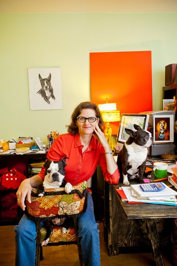 Woman at home office desk with dogs : Stock Photo