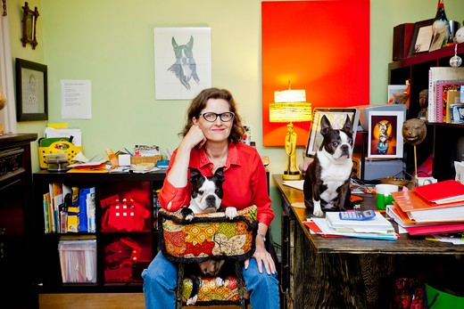 Stock Photo: 1530R-41669 Woman at home office desk with dogs