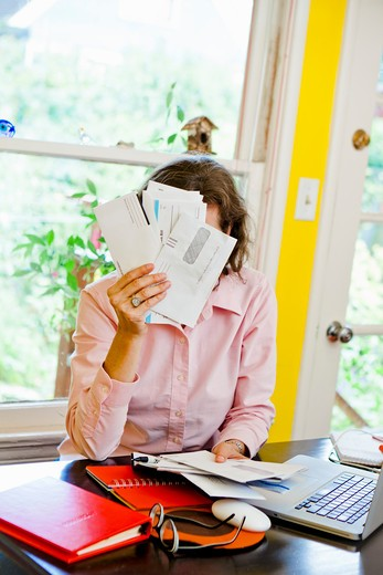 Stock Photo: 1530R-41683 Woman paying bills