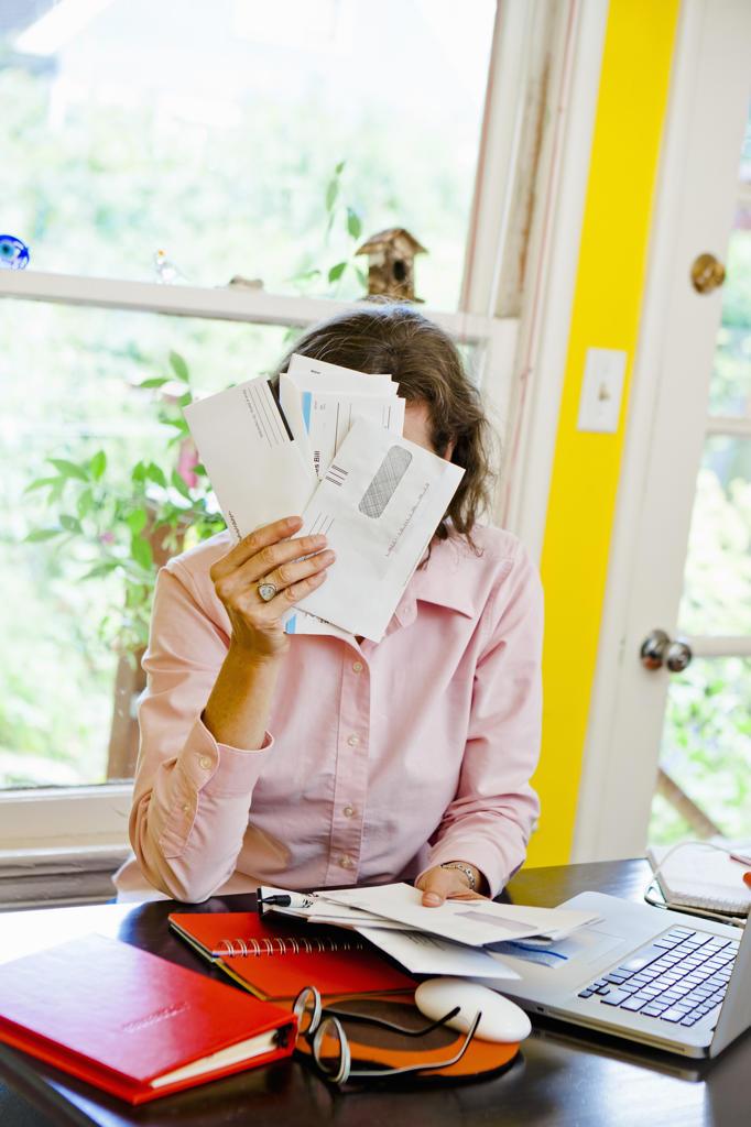 Woman paying bills : Stock Photo