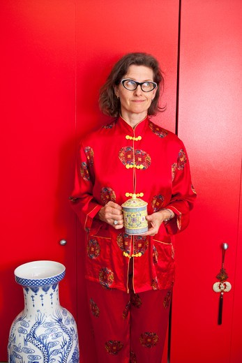 Stock Photo: 1530R-41704 Woman wearing red silk Chinese pajamas,