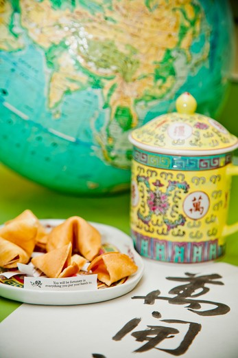 Stock Photo: 1530R-41709 Still life with fortune cookies and globe,