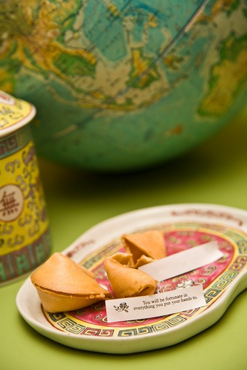 Stock Photo: 1530R-41710 Still life with fortune cookies and globe,
