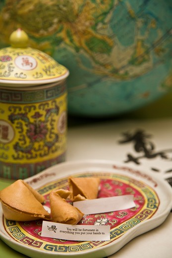 Stock Photo: 1530R-41711 Still life with fortune cookies and globe,