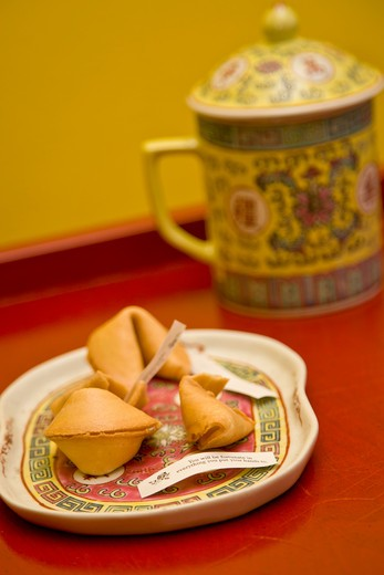 Plate of fortune cookies and tea mug, : Stock Photo