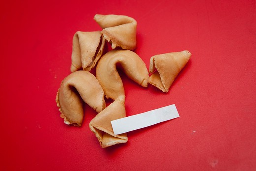 Stock Photo: 1530R-41713 Fortune cookies on red surface,