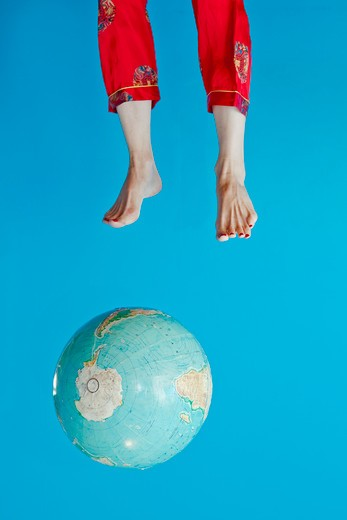 Globe and feet in air, : Stock Photo
