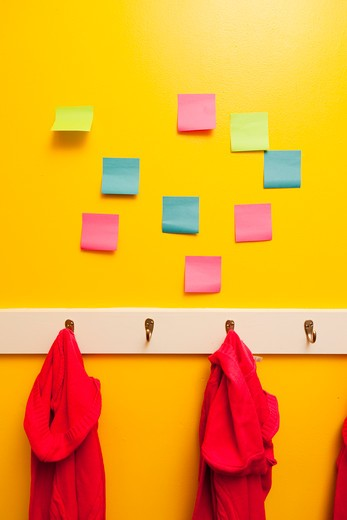 Yellow wall with colorful post-its, : Stock Photo