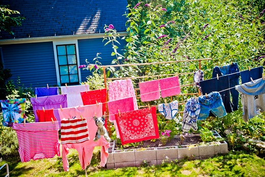 Colorful laundry hanging on outdoor lines, : Stock Photo