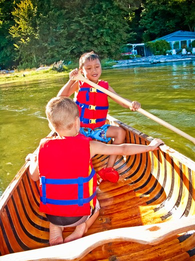 Stock Photo: 1530R-41766 Two young boys paddling canoe,