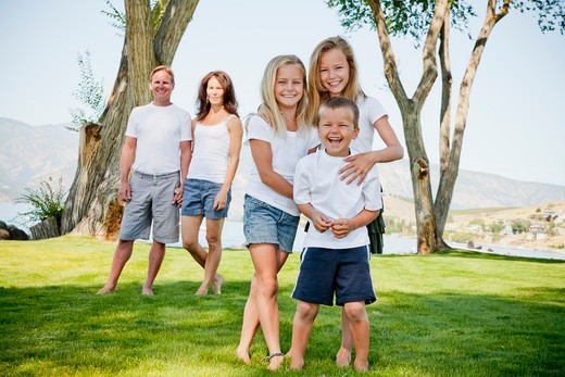 Outdoor portrait of family of five, : Stock Photo