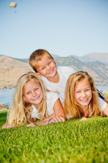 Outdoor portrait of three young children, : Stock Photo