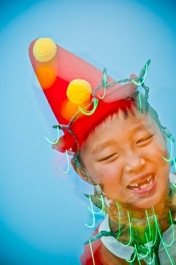 Stock Photo: 1530R-41812 Boy in red costume with holiday lights,