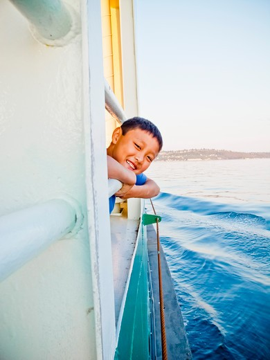 Stock Photo: 1530R-41844 Young boy looking out ferry window,  Puget Sound, Washington, USA