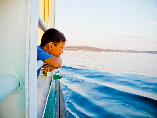 Young boy looking out ferry window,  Puget Sound, Washington, USA : Stock Photo
