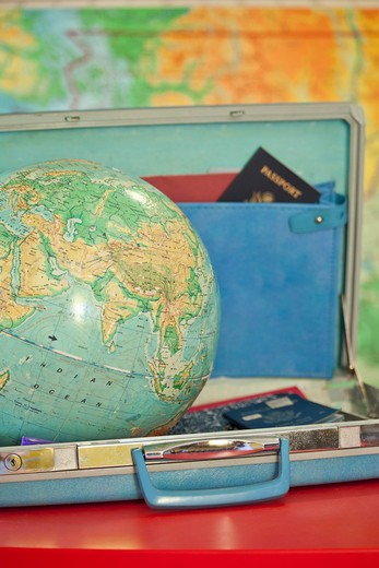 Stock Photo: 1530R-41881 Globe sitting inside open vintage briefcase