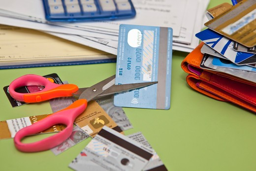 Stock Photo: 1530R-41884 Scissors cutting up credit cards