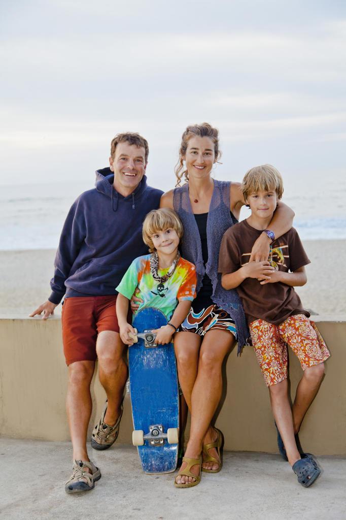 Man and woman with two boys on beach boardwalk,  Sayulita, Mexico : Stock Photo