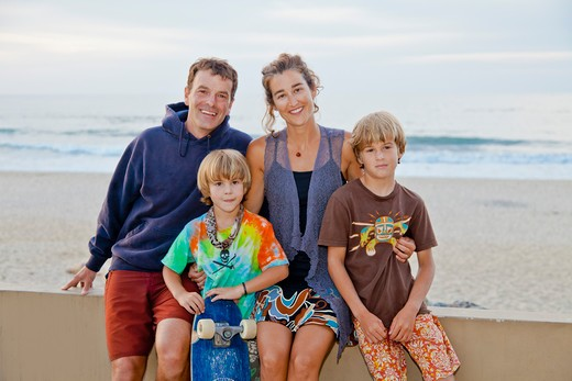 Man and woman with two boys on beach boardwalk,  Sayulita, Mexico : Stock Photo