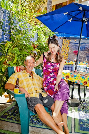 Stock Photo: 1530R-41962 Man and woman seated on festive patio,  Sayulita, Mexico