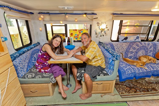Stock Photo: 1530R-41969 Man and woman holding hands at camper table,  Sayulita, Mexico