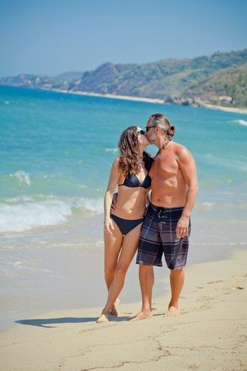 Man and woman walking on beach in swim suits,  Sayulita, Mexico : Stock Photo