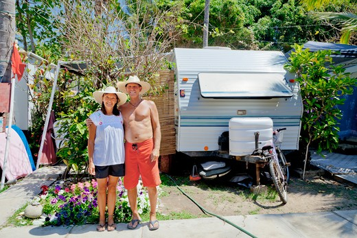 Man and woman standing in garden with camper,  Sayulita, Mexico : Stock Photo