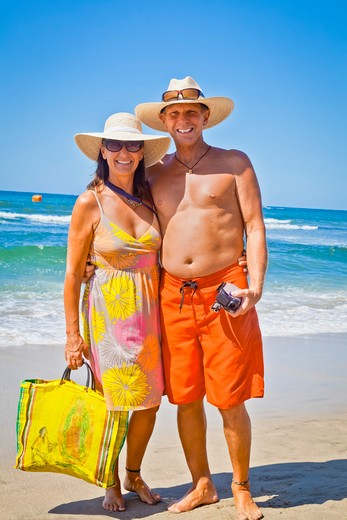 Smiling man and woman arm in arm on beach,  Sayulita, Mexico : Stock Photo