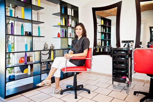 Beautician seated on chair in beauty salon,  Sayulita, Mexico : Stock Photo