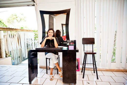 Beautician seated at manicure table in beauty salon,  Sayulita, Mexico : Stock Photo