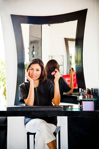 Stock Photo: 1530R-42014 Beautician seated at manicure table in beauty salon,  Sayulita, Mexico