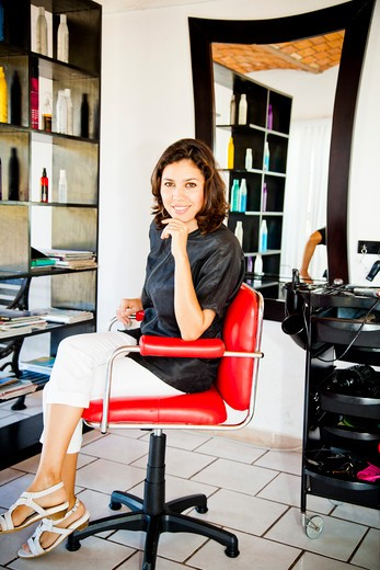 Stock Photo: 1530R-42015 Beautician seated on chair in beauty salon,  Sayulita, Mexico