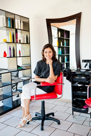 Stock Photo: 1530R-42016 Beautician seated on chair in beauty salon,  Sayulita, Mexico
