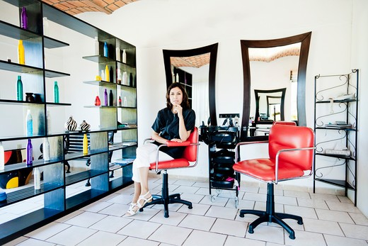 Stock Photo: 1530R-42017 Beautician seated on chair in beauty salon,  Sayulita, Mexico
