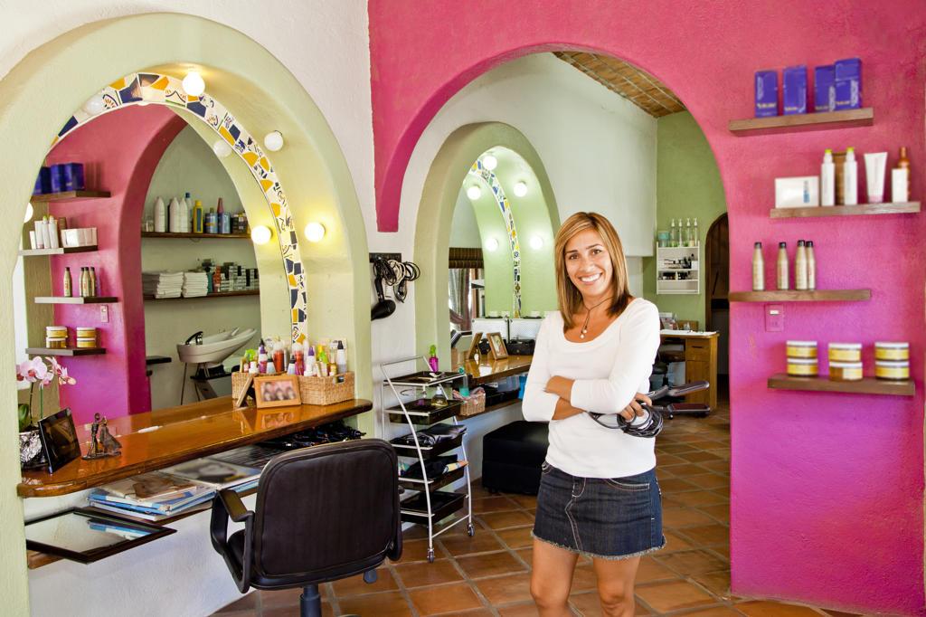 Beautician holding her tools in beauty salon,  Sayulita, Mexico : Stock Photo