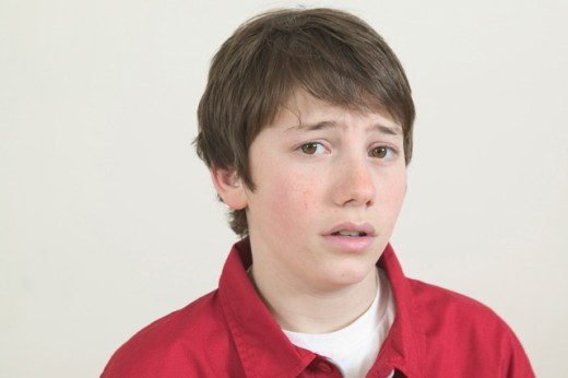 A troubled teenage boy.   : Stock Photo