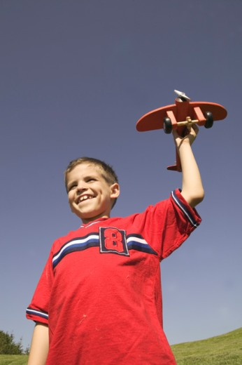 Stock Photo: 1530R-8001 Young launching a model airplane.