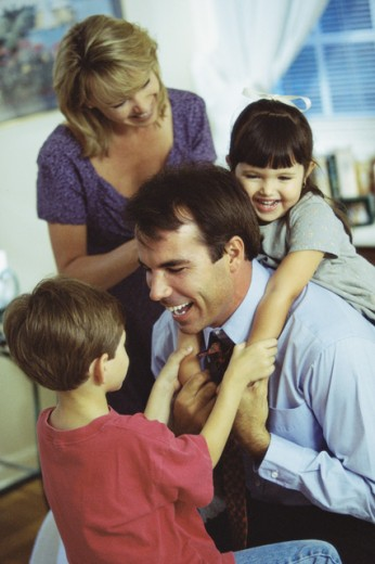 Parents playing with their children : Stock Photo
